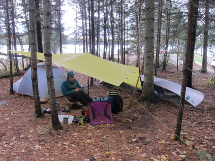 Will's excellent tarp set up plus the canoe as wind block.